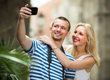 Young traveling couple taking selfie Royalty Free Stock Image