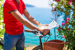 Young traveling man with map of island while Stock Photos