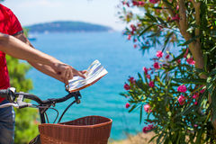 Young traveling man with map of the island Royalty Free Stock Photo