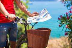 Young traveling man with map of the island Royalty Free Stock Photos