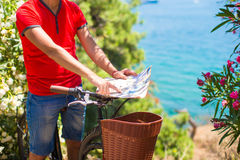 Young traveling man with map of the island Royalty Free Stock Images
