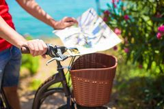 Young traveling man with map of the island Stock Images