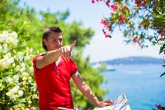 Young traveling man with map of the island Stock Photos