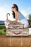 Young traveling woman Stock Images