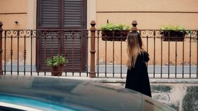 Young traveling woman exploring the new city. Attractive girl walking on the old town and looking around. Slow motion. stock footage
