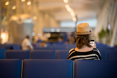 Young traveling woman waiting for transport stock photos