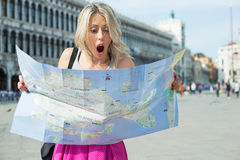 Young traveller girl looking at city map Stock Image