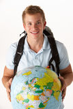 Young traveller with globe. On white background Stock Images