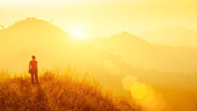 Young traveller standing at mountain at sunrise. Travel, vacatio Royalty Free Stock Photos