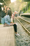 Young traveller waiting train Royalty Free Stock Photos
