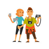 Young travelling couple with cameras and selfie stick Stock Photo