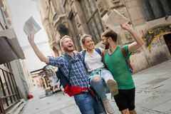 Young travelling people having fun in city Stock Images