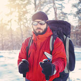 Young treker with backpack. Hiker with backpack at snowy mountain forest Stock Images
