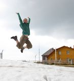 Young trekker jumping Royalty Free Stock Image