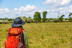 Young trekker woman with rucksack. Photo of young trekker woman with rucksack in Letea Forest Royalty Free Stock Photography