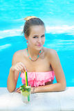 Young trendy blonde woman with a glass of refreshing lemonade Stock Photo