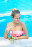Young trendy blonde woman with a glass of refreshing lemonade Royalty Free Stock Image