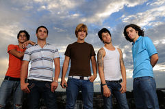 Young trendy group. Portrait of young trendy group of friends standing with attitude Stock Photo