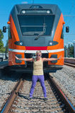 Young trendy guy in front of train Royalty Free Stock Image
