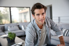 Young trendy man sitting in modern home Royalty Free Stock Images