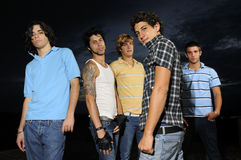 Young trendy team. Portrait of young trendy group of friends standing with attitude Royalty Free Stock Photo