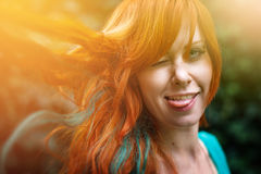 Young trendy woman with colored bright red head Stock Photo