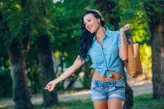 Young trendy woman doing shopping  expresses its joy Stock Photo