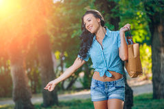 Young trendy woman doing shopping  expresses its joy Royalty Free Stock Photography