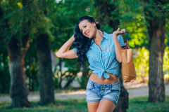 Young trendy woman doing shopping  expresses its joy Stock Photos