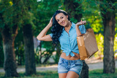 Young trendy woman doing shopping  expresses its joy Royalty Free Stock Photo