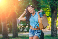 Young trendy woman doing shopping  expresses its joy Stock Image