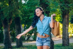 Young trendy woman doing shopping  expresses its joy Stock Photography
