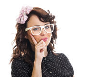 Young trendy woman. Trendy woman holding finger on her face and wearing eyeglasses. Young girl over white background Royalty Free Stock Photos