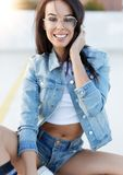 Young trendy woman in jeans denim toothy smile outdoors stock photos