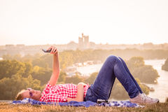 Female taking selfie on the field stock photography