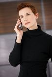 Young trendy woman on mobile call Stock Images