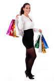 Young trendy woman smiling with shopping bag Royalty Free Stock Photo