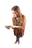 Young trendy woman typing message on smartphon Royalty Free Stock Image
