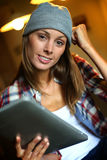 Young trendy woman using a digital tablet Stock Photo