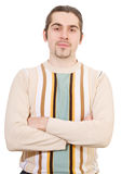 Young triumphant handsome male in sweater isolated. Young triumphant dark haired caucasian man in striped sweater isolated on white Stock Photo