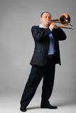 Young Trombone Player. Portrait of a young man playing his trombone Royalty Free Stock Photography