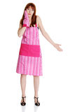Young troubled housewife in pink apron. On white Royalty Free Stock Photography