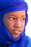 A young Tuareg. TOMBOUCTOU, MALI - JAN 08: Portrait of a young man dressed with a traditional blue Tuareg turban on January 08, 2010 in Tombouctou, Mali Royalty Free Stock Image