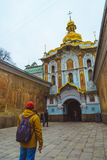 Young turist looking on old church. In Ukraine, Kiev Royalty Free Stock Photography