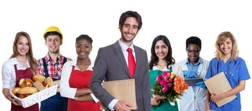 Young turkish business trainee with group of latin and african apprentices royalty free stock images