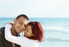 Young Turkish couple on beach Stock Photo