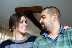 Young Turkish Couple Looking Each other At Home Royalty Free Stock Images
