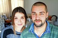 Young Turkish Married Couple At Home. In Love Together. They are looking at the camera Royalty Free Stock Photo