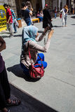 Young Turkish woman photographs friends. KONYA, TURKEY - JUN 2, 2014 - Young Turkish woman photographs friends  in the courtyard of the Mevlana Shrine,  Konya Stock Photos