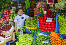 Young Turrkish boy holding vegetable stall Royalty Free Stock Photography